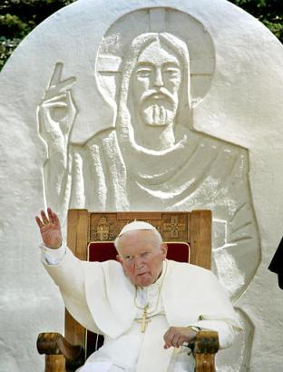 Pope John Paul (news - web sites) II waves to the crowd at the beginning of a ceremony in Zadar, Croatia, Monday, June 9, 2003, the last day of his five-day-visit to Croatia. In background is a sculpture of Jesus Christ. (AP Photo/Michael Probst)